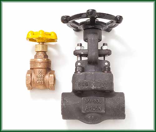 Two different Gate Valves, also known as Sluice Valves, in forged steel and brass.