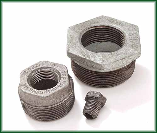 Two different Malleable Iron Hex Bushings.