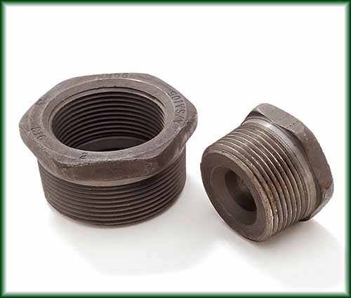 Two Forged Steel Hex Bushings.