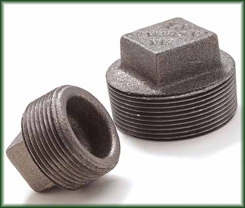 Two different Malleable Iron Plugs.
