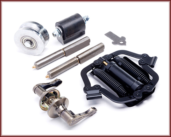 A door handle and lock, a closer, a V-Groove Tracks and Wheels, A Weld Tab and Base plate, and Guide Rollers.